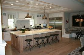kitchen island with seating for 6 large island with seating also additinal storage cabinets on the