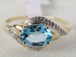 blue gemstones rings images 9ct yellow gold swiss blue topaz diamond ring gemstone rings JPG