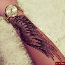 wing tattoos on arm search tattoos arms