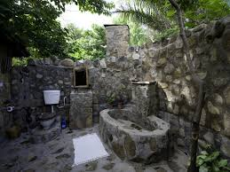 refreshing outdoor bathroom with open shower also black rocking
