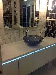 how to use lighting mirrors vanities and color in a condo bath