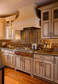 country kitchens designs remodeling htrenovations this country kitchen in new hope pa shows off a wolf gourmet series gas cooktop handmade tile plaques and backsplash limestone hood and stained glass