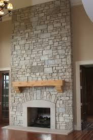 how to decorate a great stone fireplace showcasing the use of