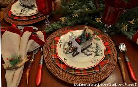christmas table setting tablescape with plaid plates and a natural