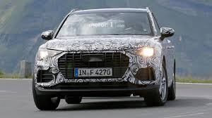 new 2018 audi q3 price 2019 audi q3 test driver smiles for the spy camera