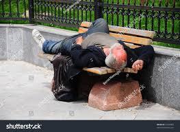 sleeping homeless man on bench im stock photo 51032863 shutterstock