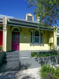 small victorian green two story brick exterior in sydney with a