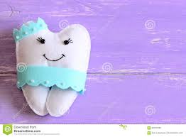 halloween background dental felt tooth fairy pillow isolated on wooden background with copy