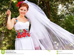 bride in the dress and the bridal veil in the ukrainian style