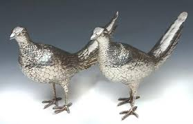 a pair of silver table ornaments in the form of pheasants 11