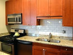 white kitchen glass backsplash glass backsplash tile white cabinet black granite countertop