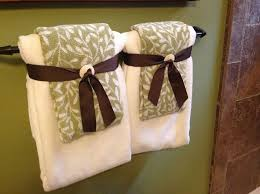 bathroom towel folding ideas bathroom fancy towel folding with dragonfly bling pinteres