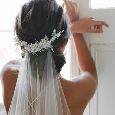 bridal hair bun flying high wedding veils above or below the bun