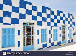 colorful and simple houses village manolas thirassia