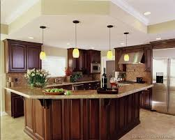 kitchen cabinet island a luxury kitchen with cherry cabinets and a large angular island bar