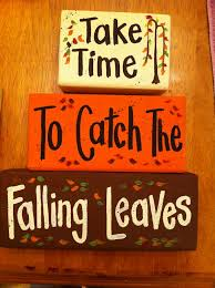 take time to catch the falling leaves sign blocks take time