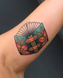 picture of colored books tattoo