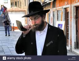 small shofar venice italy an orthodox blowing a shofar ram s