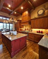 Alder Kitchen Cabinets by Knotty Alder Cabinets And Reclaimed Oak Flooring Are Elegant In