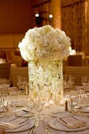 Cylinder Vase Centerpiece by Manzanita Tree Centerpieces With Yellow Orchids And Candlelight