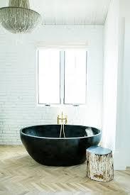 Oval Bathtub Black Lantern Over Oval Bathtub Transitional Bathroom