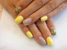 acrylic nails with yellow and silver gel polish nails