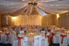 wedding ceiling decorations pink reception table with a flowery roof on top