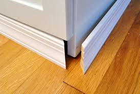 Adding Molding To Cabinets To Make Them Look Built In Baseboard - Built in cabinets for kitchen