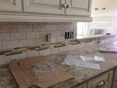Tumbled Tile Backsplash by Tumbled Marble Backsplash With Multi Colored Glass Accent Strip