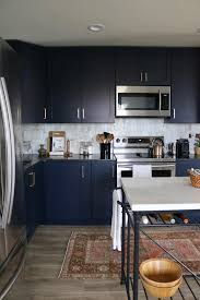 colored kitchen cabinets with black countertops blue kitchen with black cabinets page 1 line 17qq