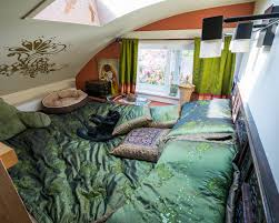 the lilypad tiny house in portland features two loft spaces and a