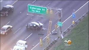 crash victim ejected from vehicle lands on freeway sign in