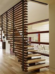 contemporary staircase with high ceiling by carney logan burke
