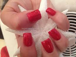 red glitter with freehand snowflake nail art and swarovski crystal