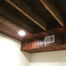 hide duct work and ceiling wires in basement with something a bit