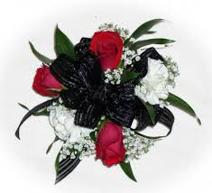 black and white corsage 3 roses 2white carns black bow wrist corsage in akron pa