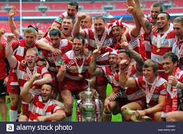 uk 24th aug 2013 wigan warriors players celebrate with