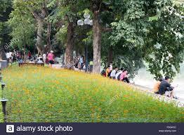 Flower Garden Hanoi by Vietnamese People Relaxing Around Hoan Kiem Lake In Hanoi City