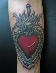 sacred heart tattoo is worn by men and women equally best tattoo