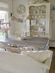 shabby chic kitchen design with farmhouse style table and vintage