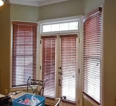 wood blinds in a bay window u0026 doors windowtreatments www