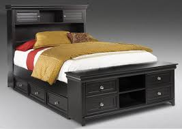 Black Wooden Bed Frames Black Wooden Bed With Two Shelves On The Middle Of Four Front