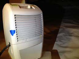 how to choose between freestanding and built in basement dehumidifiers