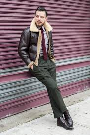 nail that dapper look with a dark brown shearling jacket and army green wool dress pants