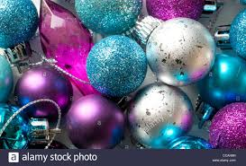 purple christmas tree blue silver and purple christmas tree baubles in a box stock