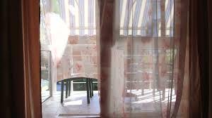 view from hotel room through open glass door window to balcony