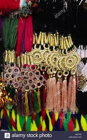 pakistan crafts detail of beaded tasseled hair ornamentation stock
