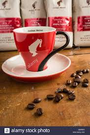 julius meinl coffee cup and whole coffee beans stock photo