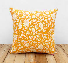 yellow ochre kalamkari cushion cover from the exclusive home