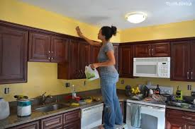 how easy is it to paint your kitchen cabinets how to paint a kitchen in just a few hours thrift diving
